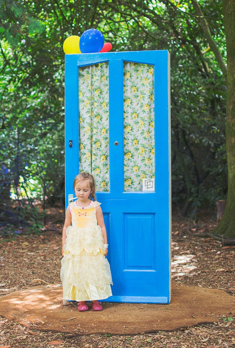 blue-door-in-woods-larmer-tree-festival